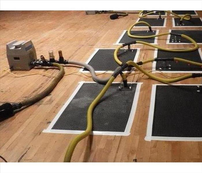 Dallas Gym Floor Sustains Water Damage