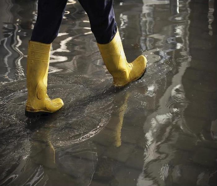 boots walking in flooded property