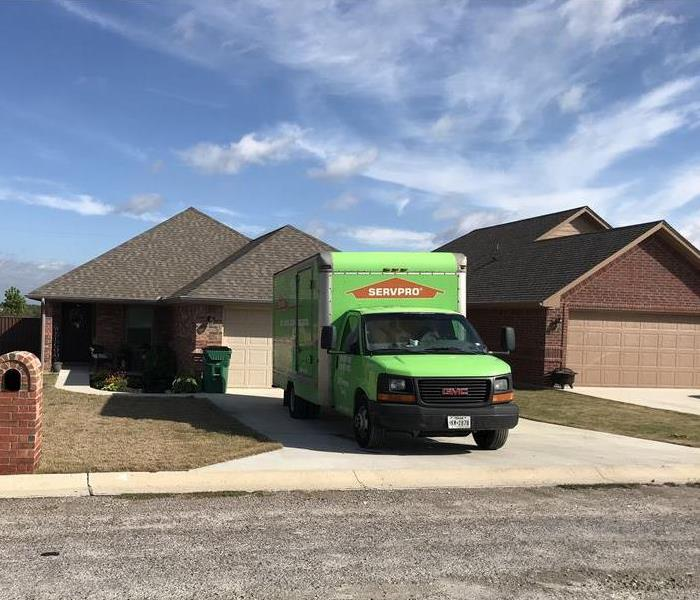 SERVPRO truck parked in a driveway.