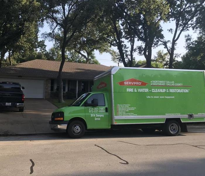 SERVPRO truck parked in front of a home.