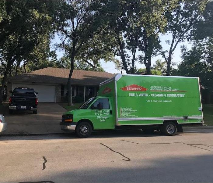 SERVPRO vehicle parked in front of home