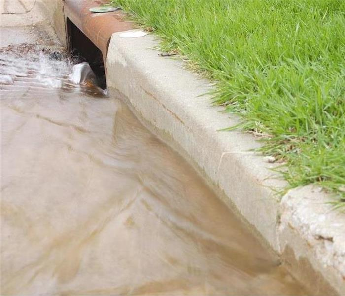 Storm Damage Clogged Drains at the Curb Can Cause Flood Damage to Dallas Homes
